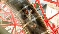 A Woman going down the slide at the ArcelorMittal Orbit