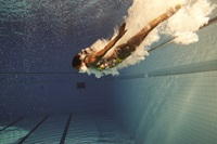 person diving into a pool