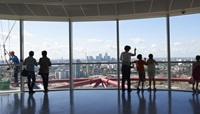 Visitors looking at the skyline view at the ArcelorMittal Orbit